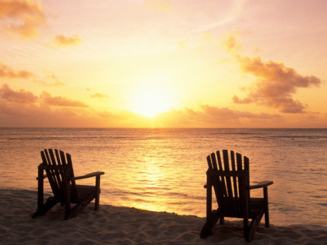 sergio-pitamitz-empty-beach-chairs-at-sunset-denis-island-seychelles